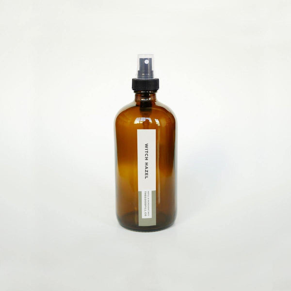 Product image of an 8oz glass amber bottle with a black spray top for zero waste witch hazel refills.