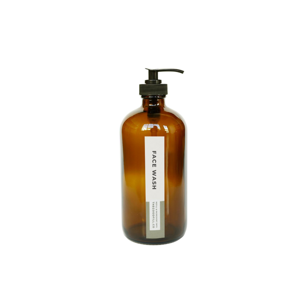 Product image of an 8oz glass amber bottle with a black pump top for zero waste face wash refills.