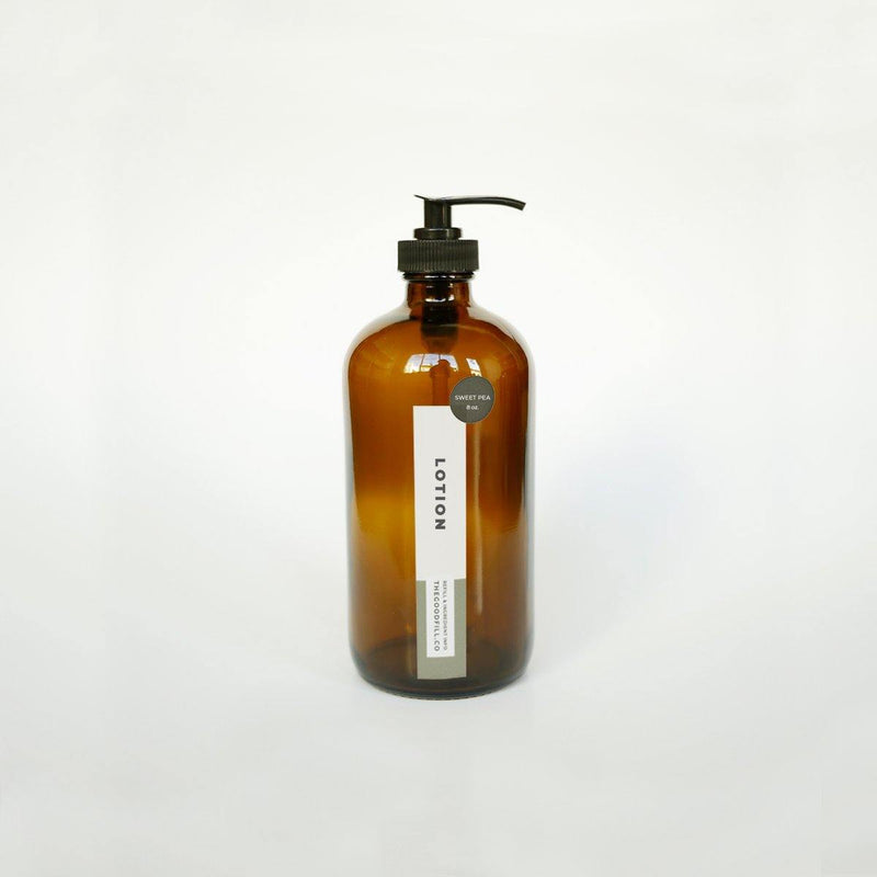 product image of 8oz. amber glass bottle with black pump top, rectangle product label, and round scent sticker for zero waste lotion refills