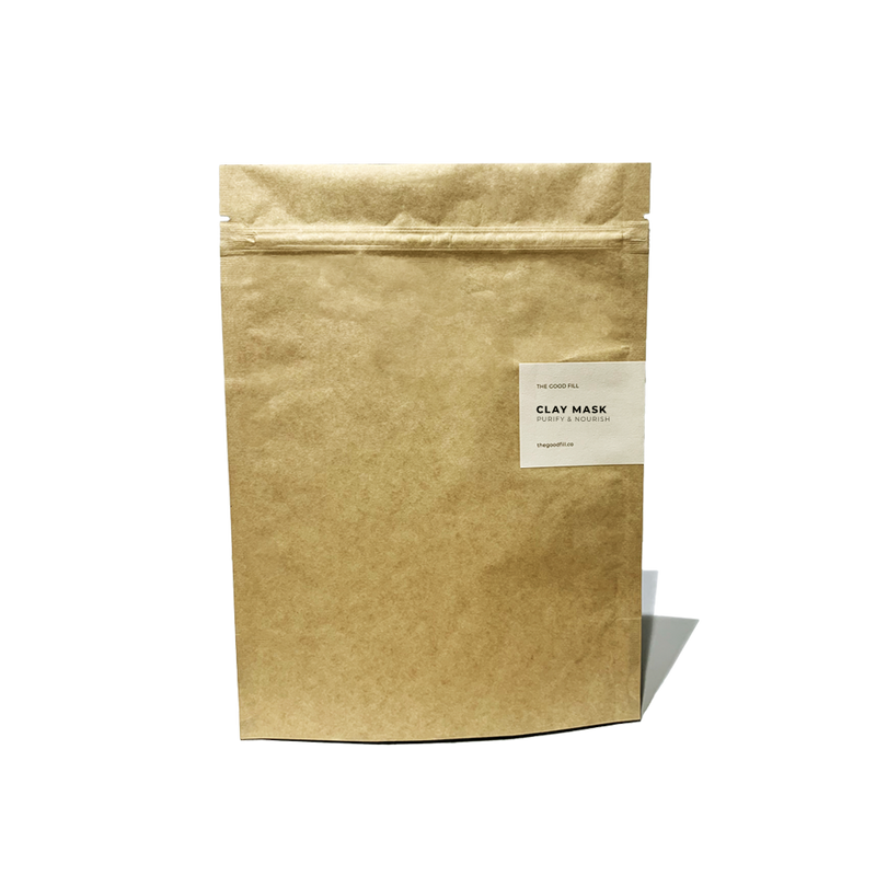 Product image of an 8oz compostable paper packet for zero waste clay mask refills.