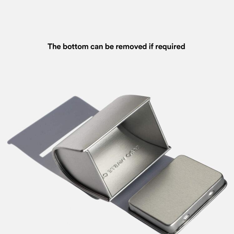 Product image showing how the bottom of the tin opens for emptying the razors.
