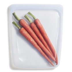 image of a reusable, zero waste clear gallon sized stasher bag containing fresh carrots.