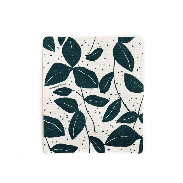 product image of a zero waste, reusable swedish dish cloth that has a hand drawn print of green leaves on a white background.