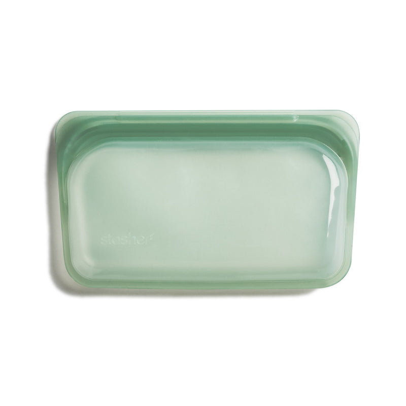 product image of an empty zero waste, green colored snack sized stasher bag sitting on a white background.