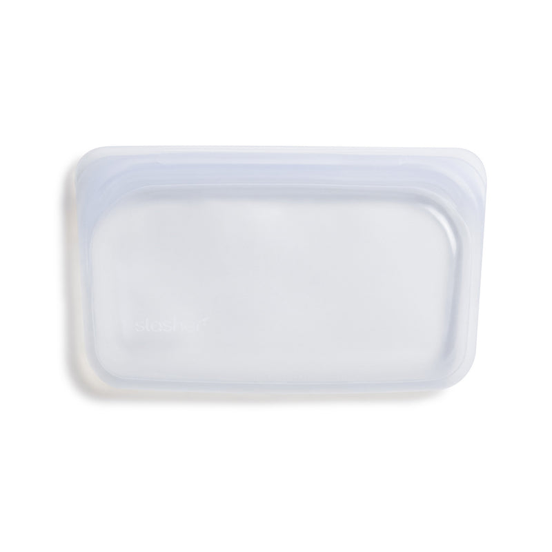 product image of an empty zero waste, clear snack sized stasher bag sitting on a white background.