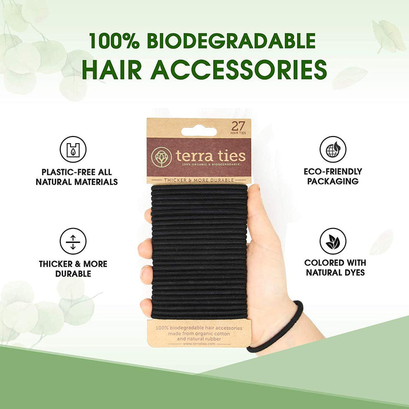 hand holding a pack of 27 black hair ties - featuring that they are 100% biodegradable, natural dies, and plastic free