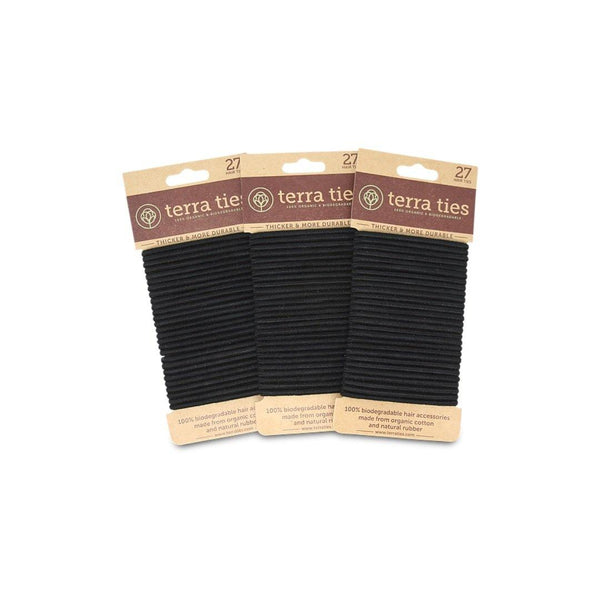 packs of 27 black hair ties on a brown, plastic free cardboard holder