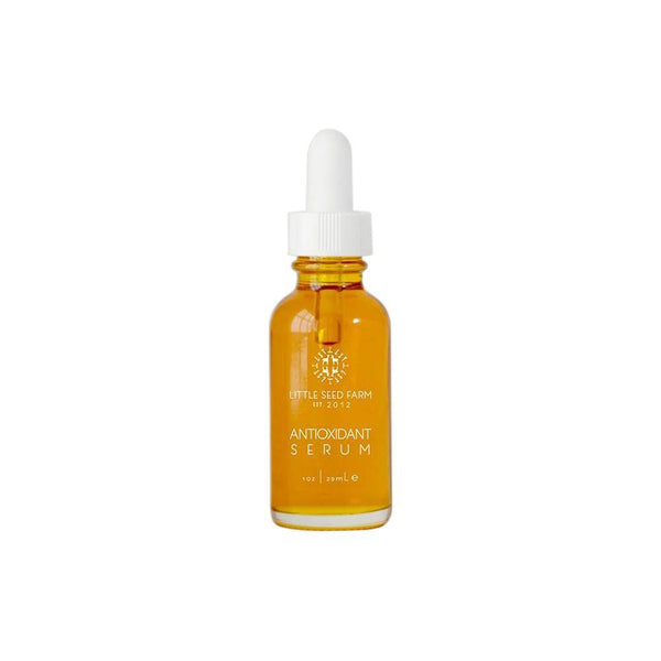 Product image of antioxidant serum in a clear glass dropper bottle.