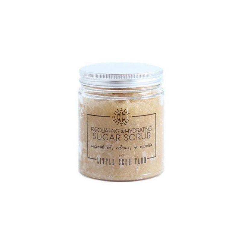 clear glass jar with aluminum twist off lid and filled with light brown organic sugar scrub