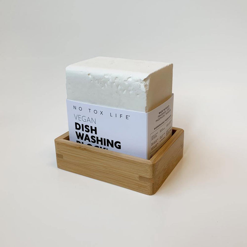 product shot of brown, rectangle bamboo soap dish holding the zero waste XL-Dishwashing block