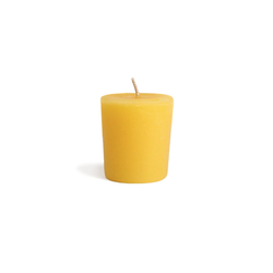 Yellow all natural beeswax votive candle for zero waste candle refills.