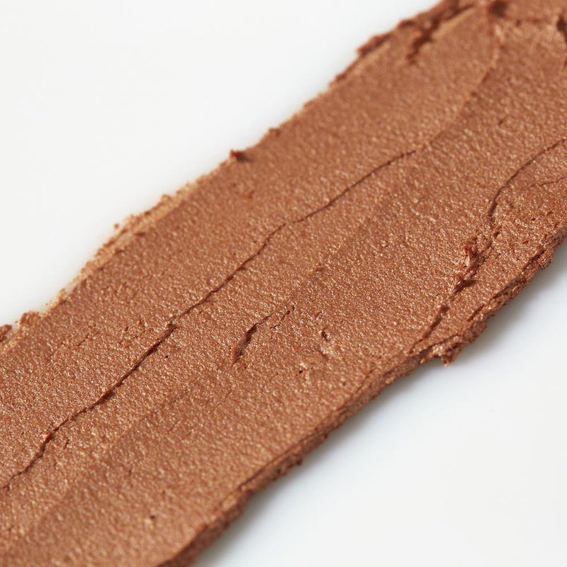 Product image of a caramel balmie color smeared across a white background