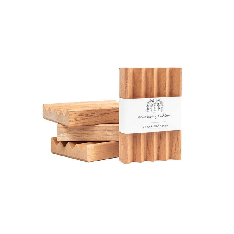 Product image of natural cedar soap dishes stacked.