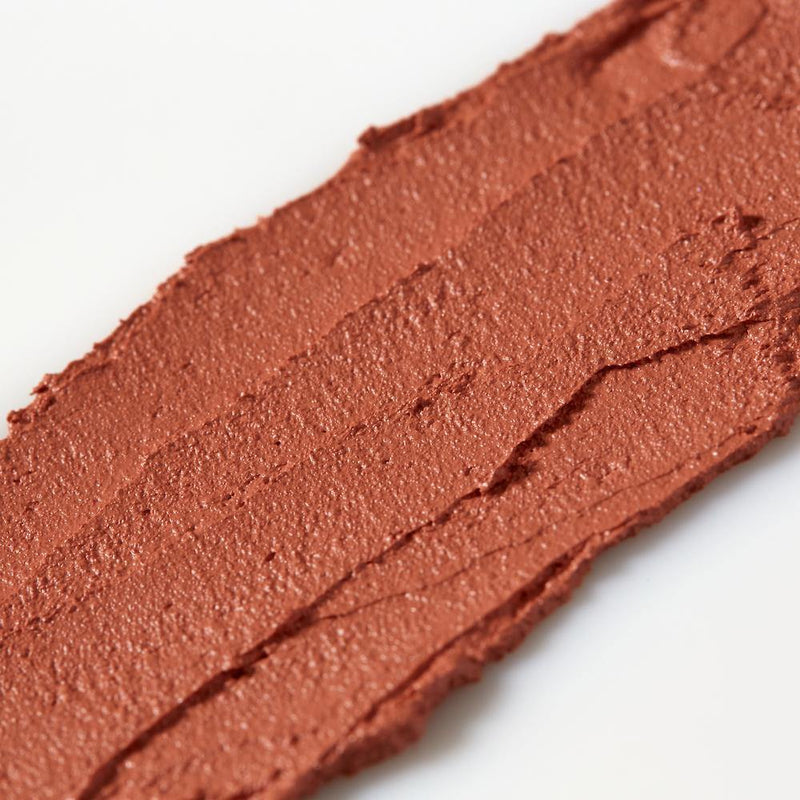 Product image of a red with orange toned balmie color smeared across a white background