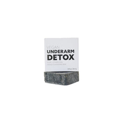 product image of charcoal colored, square underarm detox bar. There is a white recyclable packaging box with black bold print.