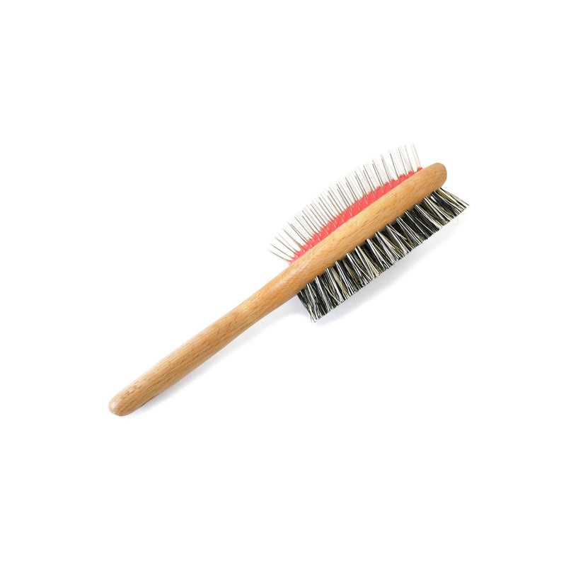 product image of a double sided, wooden pet brush. One side of the brush head has soft bristles and the other side has metal pin bristles.