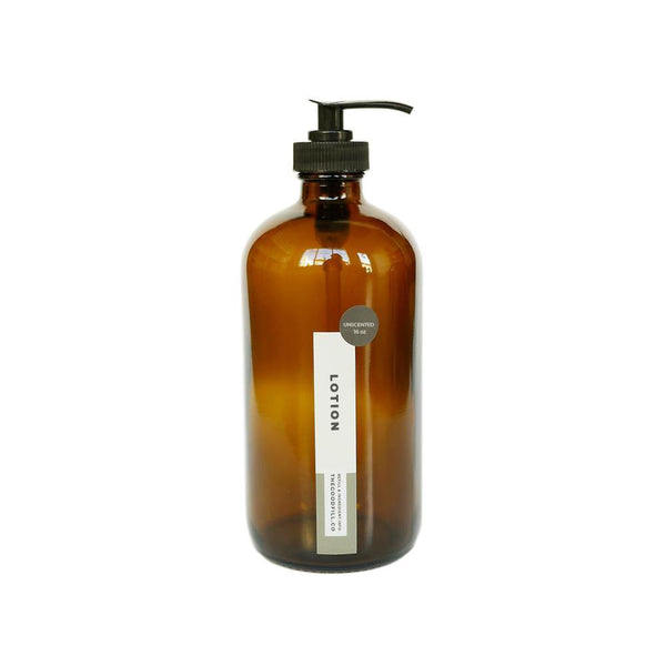Product image of a 16oz glass amber bottle with a black pump top for zero waste face and body lotion refills.