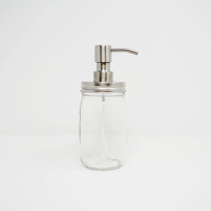 product image of a reusable, zero waste silver stainless steel foaming mason jar pump on a clear mason jar.