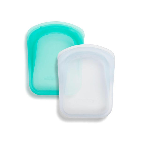product image of two pocket size stasher bags side by side. One is a clear/white color and the other is a turquoise color
