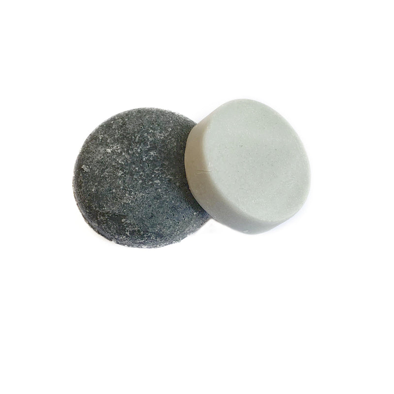 package free round dark grey peppermint tea tree shampoo bar and a round light grey peppermint tea tree conditioner bar