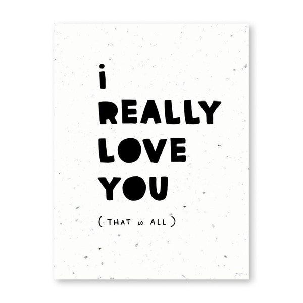 "a white card with black print that says ""i really love you (that is all)"""