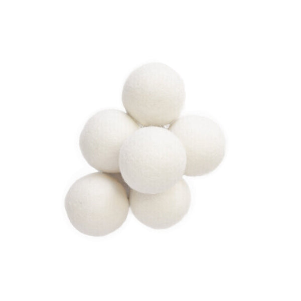 a pile of six zero waste, package free, white wool dryer balls