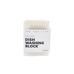 product image of a white zero waste dishwashing block in white paper sleeve packaging that has bold black print.