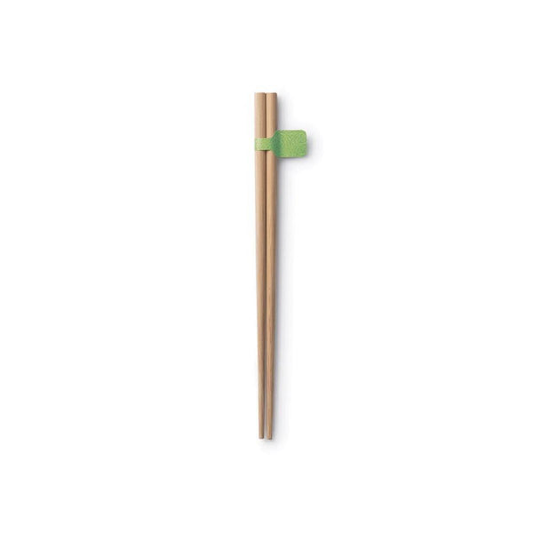 a pair of natural brown bamboo chopsticks sitting on a white background.