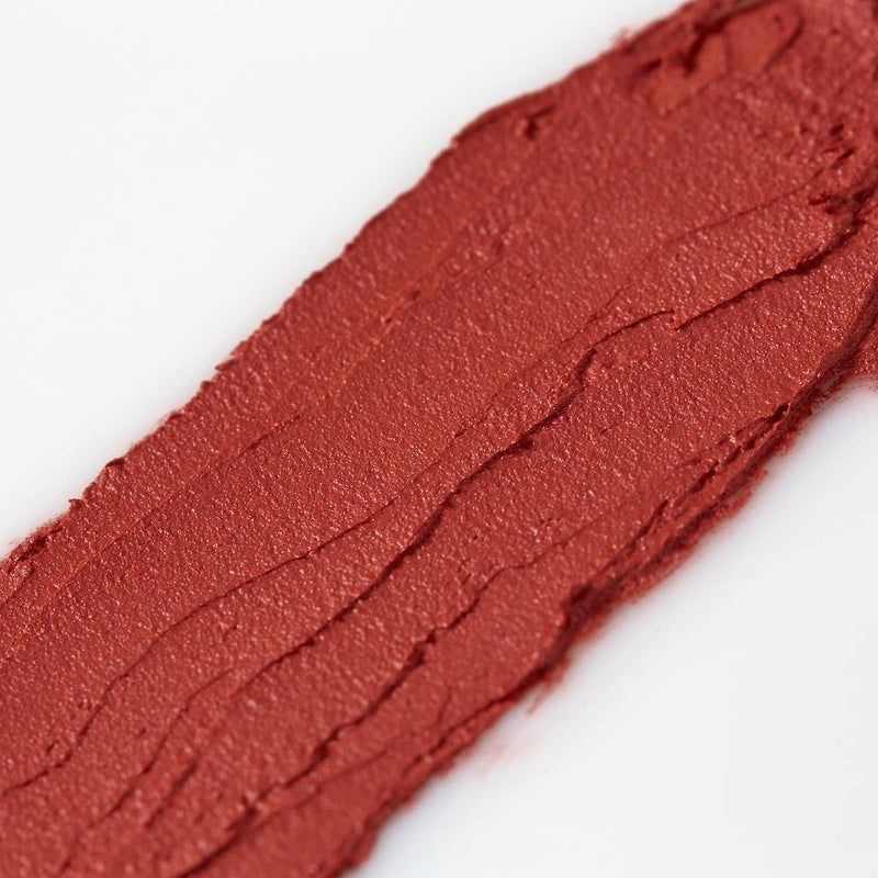 Product image of a bright red balmie color smeared across a white background