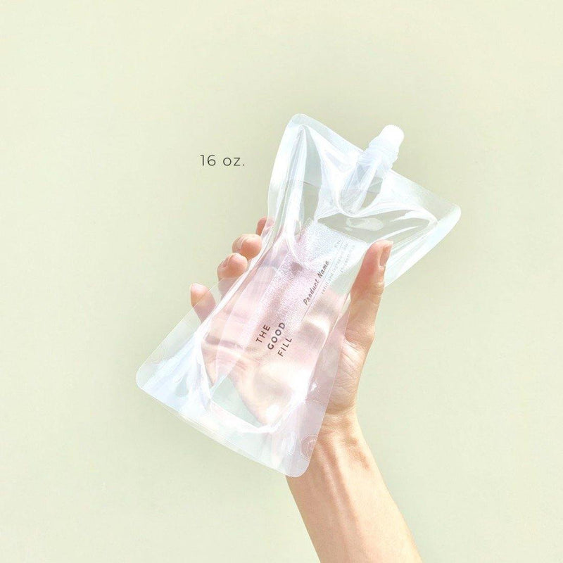 hand holding a zero waste 16oz. clear bulk re-fill pouch for castile soap refills