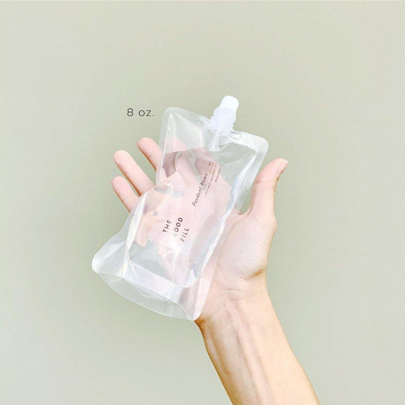 hand holding an 8oz. clear zero waste refill pouch for package free bug spray refills