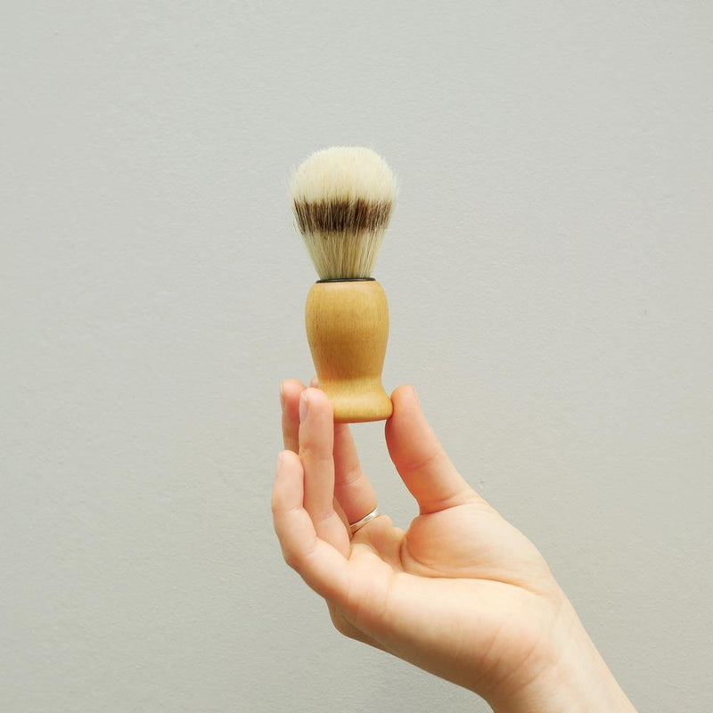 Picture of a hand holding up a shave brush