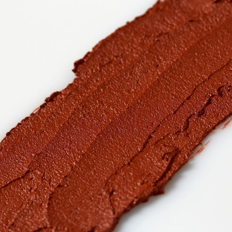 Product image of a red balmie color smeared across a white background