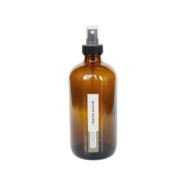 Product image of a 16oz glass amber bottle with a black spray top for zero waste witch hazel refills.