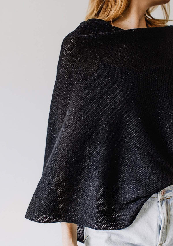 Closeup of sparkly black knit nursing cover on Emily Baldoni