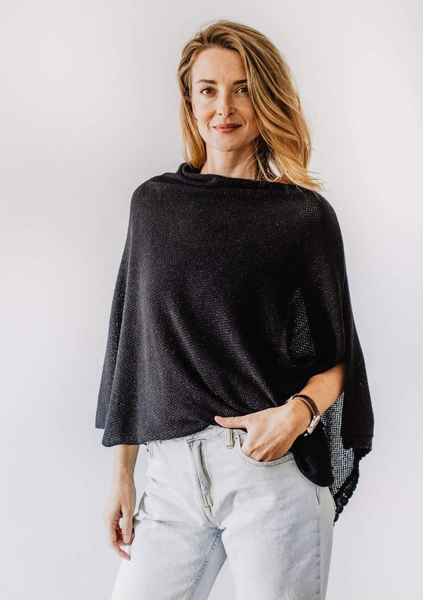 Emily Baldoni wearing sparkly black knit nursing cover styled as cape