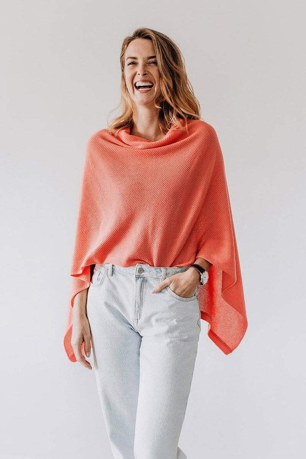 Emily Baldoni wearing coral knit Cocoon nursing cover styled as cape