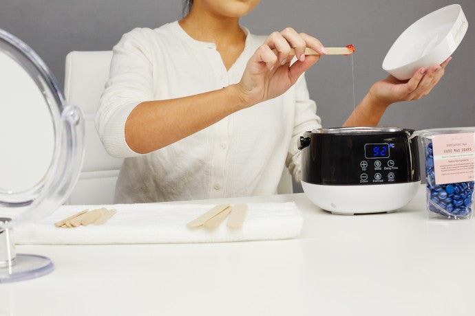 Women using the Sparkly Home Wax Kit