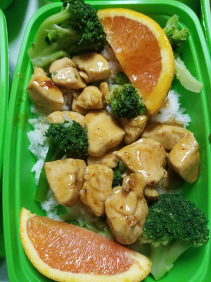 orange chicken with broccoli and orange slices  best meal delivery