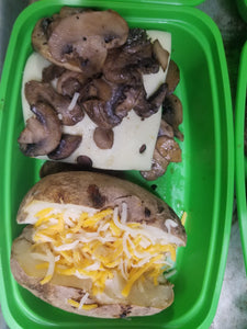 burger with cheese and mushrooms with a baked potato  best meal delivery