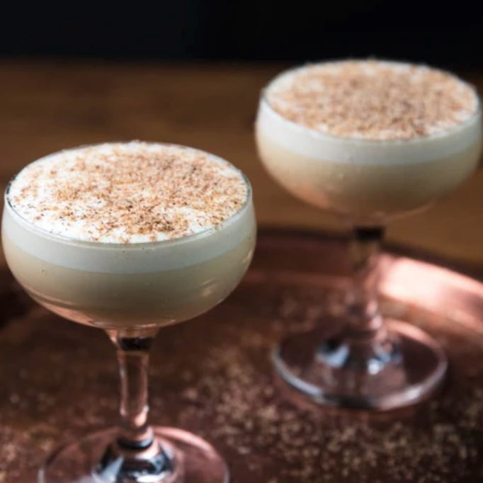 Glasses of eggnog made with Token Calder Chai Bitters