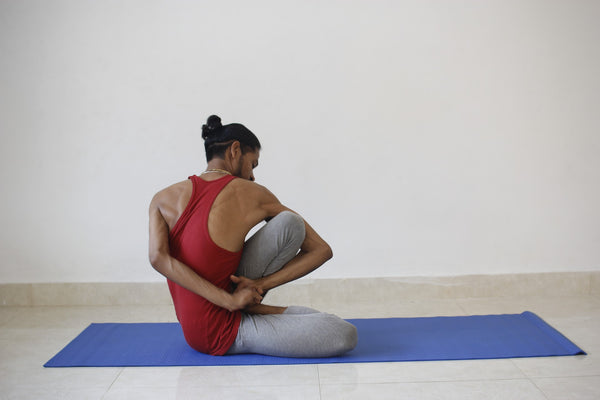Man doing yoga to keep joints healthy