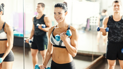 Image of female athlete light dumbbell reps to recover from DOMS quickly