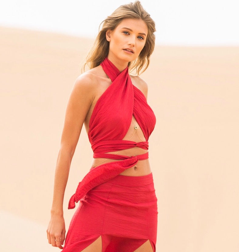 Our wrap top is designed to be worn in multiple different ways, featuring our favorite cutout silhouette, and accentuating a plunging waistline. This versatile top is perfectly paired with our Arabian skirt and great for a day or summer night look.