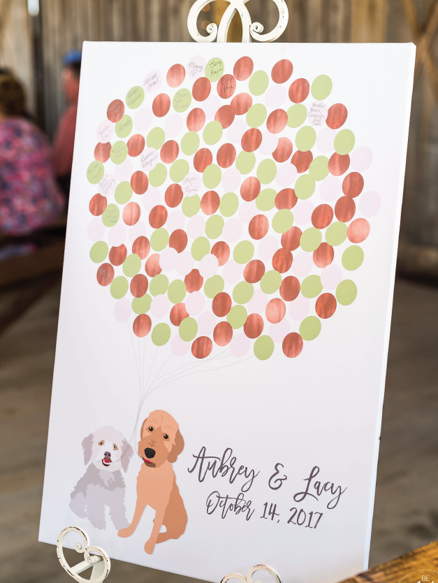 Wedding guest book canvas with two dogs holding balloons