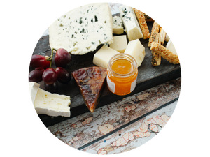 Cheese selection with honey and dried fruit