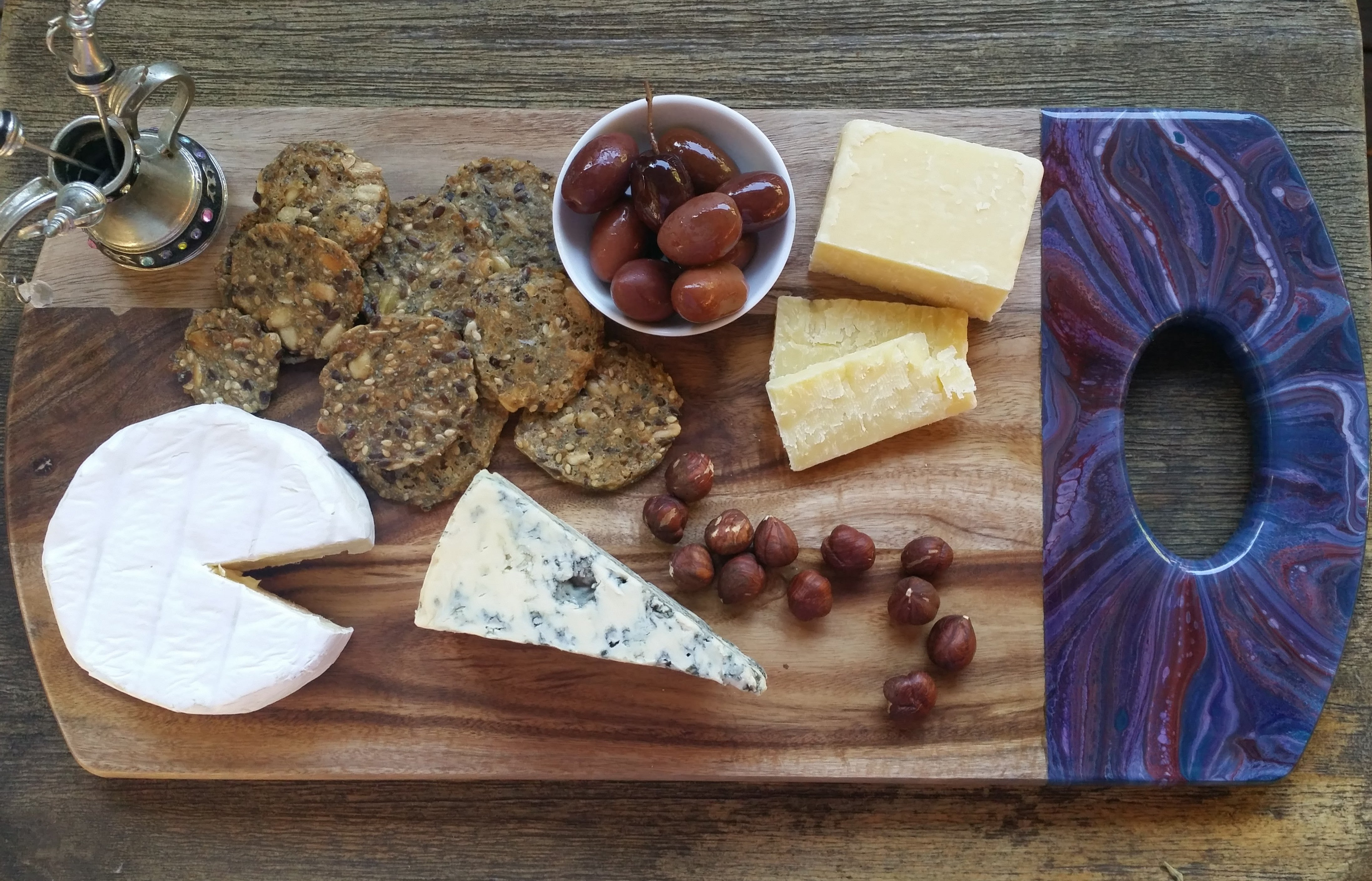 Resin serving board with selection of cheese