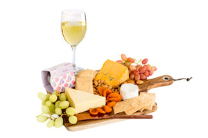 Small Australian cheese platter with white wine
