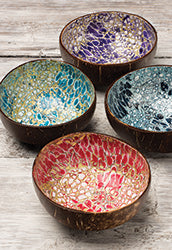 Four different colour coconut bowls decorated with egg shells on the inside