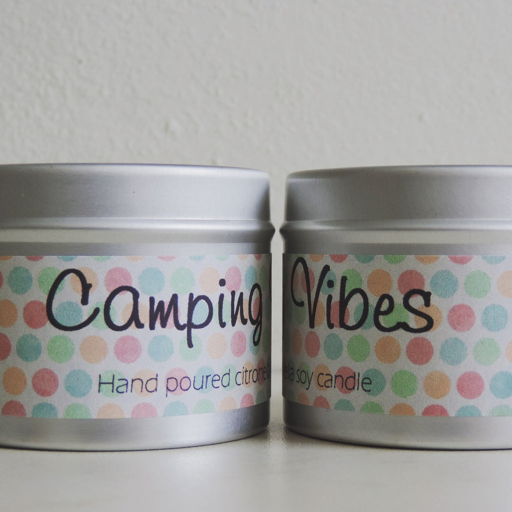 Handpoured citronella candles with label saying camping vibes